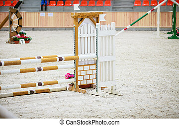 Yellow blue white obstacle for jumping horses Riding...