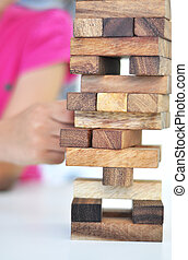kid playing with wooden blocks