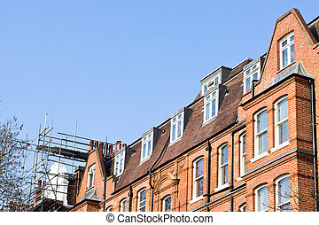 Scaffolding on a red brick building in London