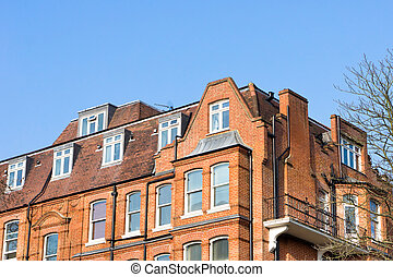 London architecture - Corner of a large red brick building...