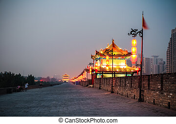 xian ancient city wall at night, beautiful gate tower ablaze...
