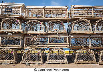 Lobster traps - Stacks of wooden lobster traps on pier in...