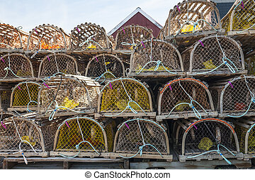 Lobster traps - Stacks of wooden lobster traps in North...