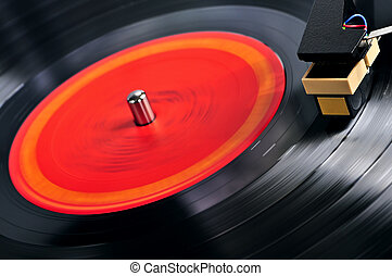 Record on turntable - Vinyl record spinning on turntable...