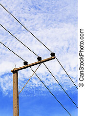Electric poles on blue sky