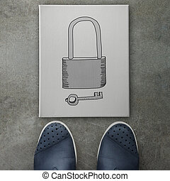 hand drawn of padlock and key on canvas board on front of business man feet as  Security concept