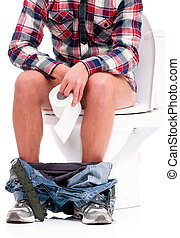 Man on toilet bowl - Man is sitting on the toilet bowl,...
