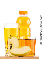 Apple juice in plastic bottle and glass on wooden board over...