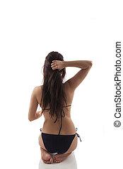 Yoga practice. - Attractive brunette kneeling and touching...