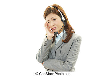 Tired call center operator - Tired, sad business woman at...