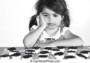 Little girl wants to eat lots of chocolate cookies.Concept...