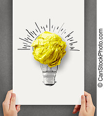 hand drawn light bulb with crumpled paper ball on paper...
