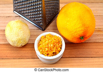 Grated citrus rind - Grated citrus orange and lemon rind and...