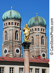 Munich - The golden sculpture of Saint Mary with the Church...