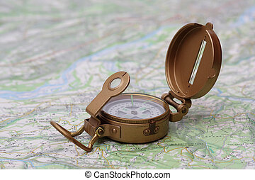 Brass compass on a topographic map