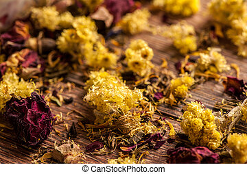Dry flowers petals - Dry yellow flowers petals on wooden...