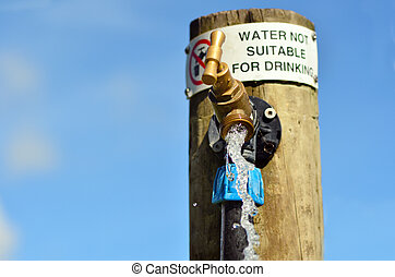 Water not suitable for drinking sign on outdoor water tap....