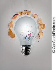 3d render light bulb with pencil saw dust on paper background as creative concept