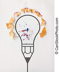graphic pencil light bulb with pencil saw dust on paper...