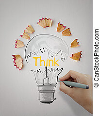 hand drawn light bulb word design THINK with pencil saw dust on paper background as creative concept