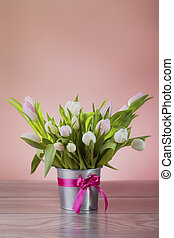 Rustic pot with white fresh tulips