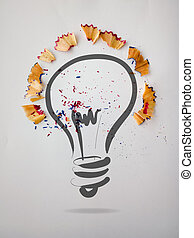 hand drawn light bulb with pencil saw dust on paper background as creative concept