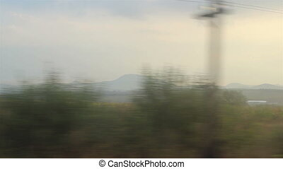 Nature View from Running Train - Landscapes with hills and...