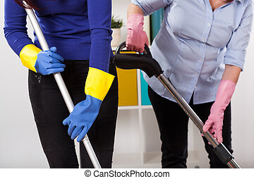 Women during cleaning floor - Women wearing protective...