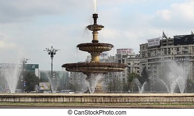 Large Fountain in Bucharest - A large fountain with many...