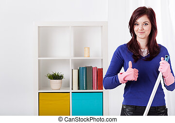 Smiling woman during housework - Smiling woman with okay...