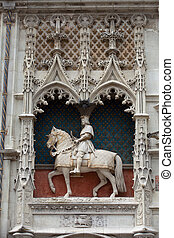 Statue of King Louis XII on the entrance to Chateau de Blois...