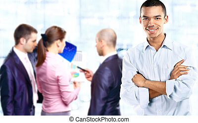 Successful african businessman at the office leading a group