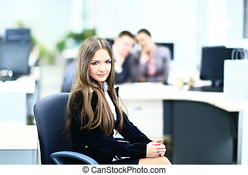 Portrait of a cute business woman with colleagues at the background