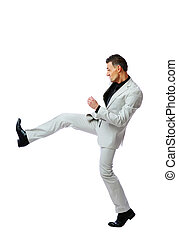 Full length of angry businessman imitating a fight standing against white background