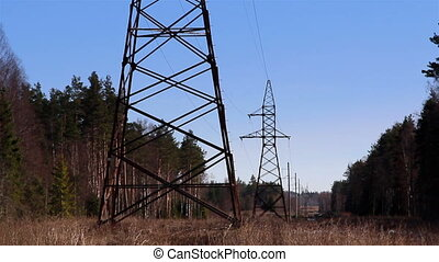 Two electricity tower in the forest - Two electricity cable...