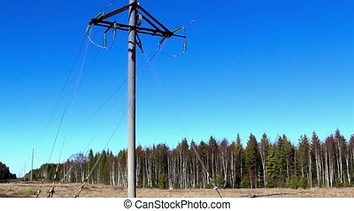 A power post with some cable wires on it - A power post with...