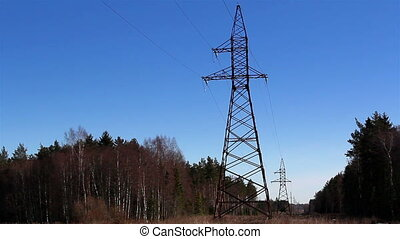 Two electricity power tower on the middle of the forest with...