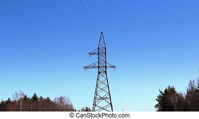 Closer look of the electricity tower with cable wires on it