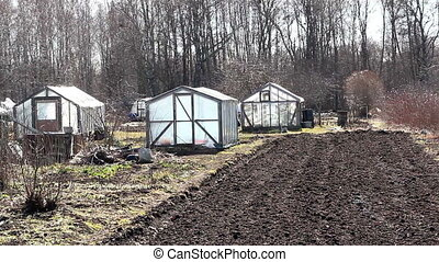 Some greenhouse on the field - Some greenhouse located in...