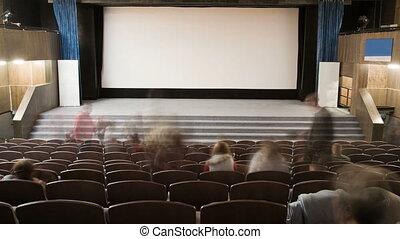 Cinema auditorium with people - Cinema auditorium is...
