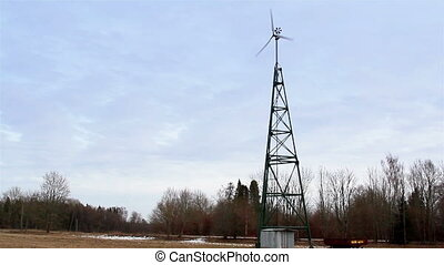 Water wind turbine on a metal tower - Water turbine on a...