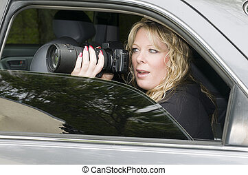female private investigator with camera - female private...
