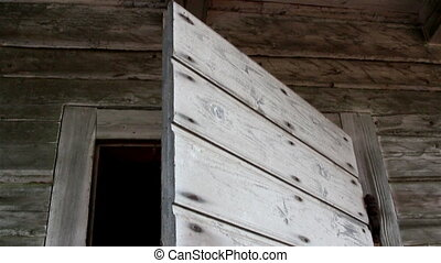 Wooden shakes of a door of an old house