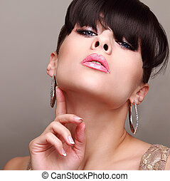 Sexual glamour bright makeup woman. Hair style with fringe. Manicure nails.