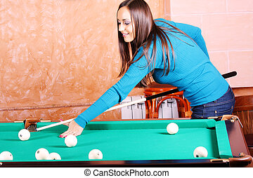 Woman in blue jumper playing billiards - Pretty woman in...