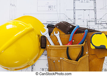 Close up of home plan with work tools