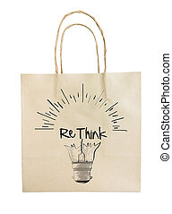 Hand drawn light bulb with RETHINK word paper recycle bag on...