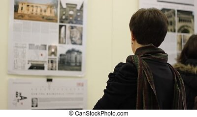 Girl Looking at Exposition - A girl with scarf is looking to...