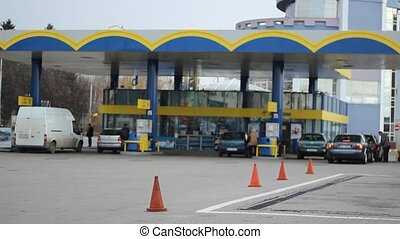 Cars Refuel In Gas Station - Cars at the filling station...