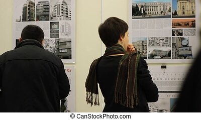 Girl Watching the Exhibition - A girl looks at an exhibition...